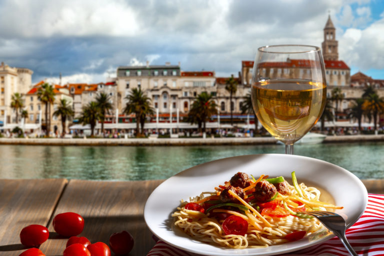 pasta-with-a-plate-of-sauce-on-the-table-in-croatia-split-2