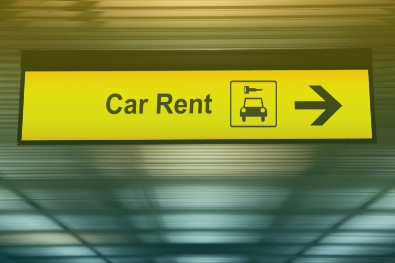sign-with-arrow-point-to-rent-a-car-service-at-the-airport-for-passenger-who-want-to-hide-a-car-for-travel-around-city-freedom-transportation-for-convenient-travel